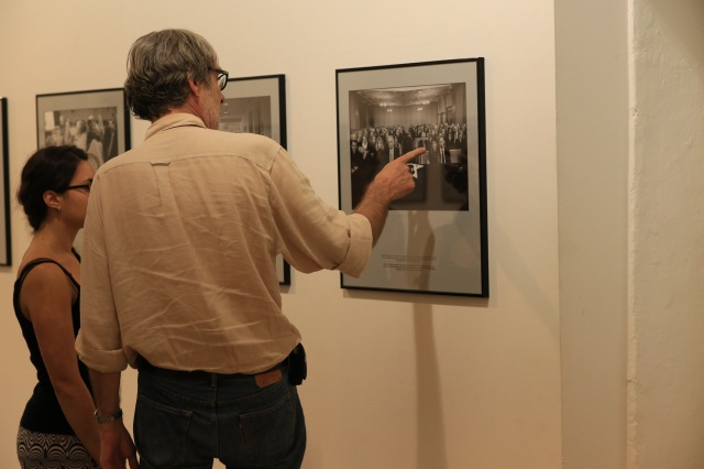 Jean-François Leroy, telling the story of a photograph hanged at the Couvent des Minimes during the last check on the exhibitions. Photo : Didier Cameau